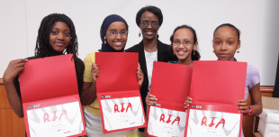 a photo of young women earning thier award